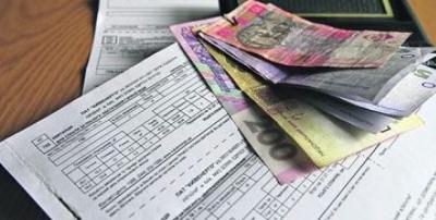 Українці накопичують борги за житлово-комунальні послуги