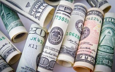 Долар обвалився до трирічного мінімуму до світових валют
