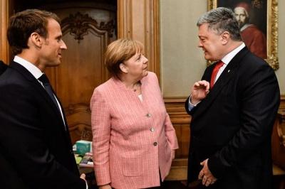 Порошенко провів зустріч з Меркель та Макроном