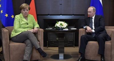 ЗМІ: Путін висунув Меркель умову щодо миротворців на Донбасі