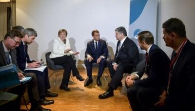 Порошенко, Макрон та Меркель обговорили введення миротворців на Донбас