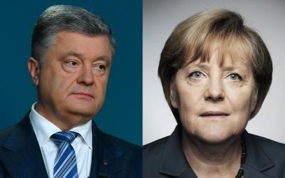 Порошенко закликав Меркель посилити санкції проти Росії через роздачу паспортів