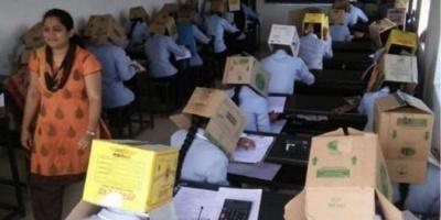 В індійському коледжі зі списуванням боролися одягнувши студентам коробки на голови